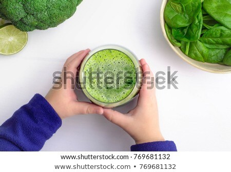 child's hand holding a lemon with a leaf Stock photo © phbcz
