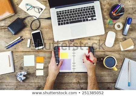 Laptop irodaszerek felülnézet fehér üzlet iroda Stock fotó © karandaev