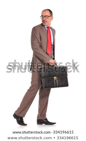 happy old businessman with briefcase walking forward Stock photo © feedough