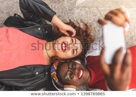 Happy female friends taking selfie Stock photo © wavebreak_media