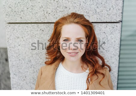 Portrait of woman with curly hair lean on bust Stock photo © deandrobot
