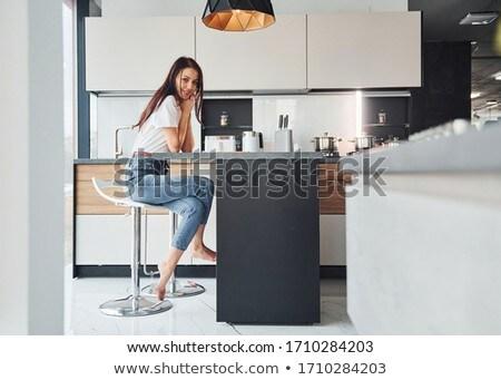 женщину сидят кухне дома книга весело Сток-фото © IS2