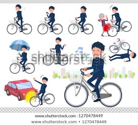 school boy gakuran ride on city bicycle Stock photo © toyotoyo
