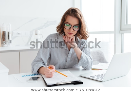 A businesswoman with documents and pencil stock photo © vladacanon