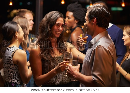 friends with drinks dancing at rooftop party Stock photo © dolgachov