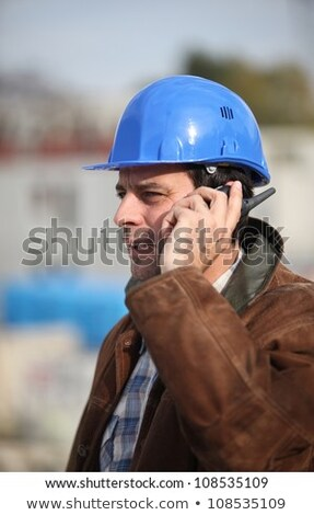 Engineer speaking into his walkie-talkie Stock photo © photography33