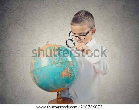 Portrait of boy holding a ball in a classroom Stock photo © wavebreak_media