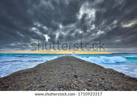 óceán · móló · viharos · nap · fából · készült · hullámok - stock fotó © trgowanlock