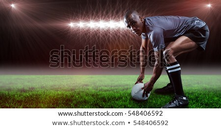 composite image of portrait of smiling rugby player holding trop stock photo © wavebreak_media