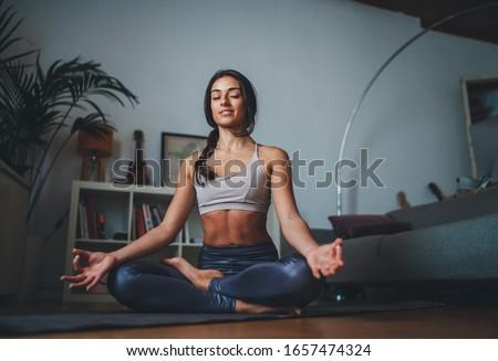 Kadın yoga egzersiz stüdyo uygunluk spor Stok fotoğraf © dolgachov