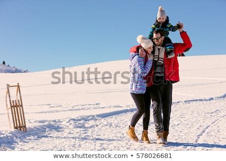 Apa lánygyermek élvezi hó nappal szeretet Stock fotó © Lopolo
