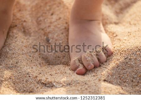 Children's feet on the seaweed Stock photo © galitskaya