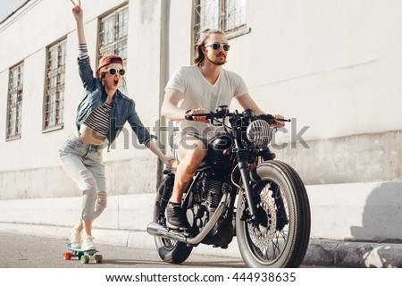 teenage couple riding skateboards on city road Stock photo © dolgachov