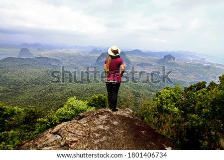 Woman stood by bamboo Stock photo © photography33