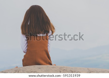 Woman sitting on a deserted beach Stock photo © photography33
