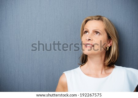 Thoughtful woman looking up against a white background Stock photo © wavebreak_media