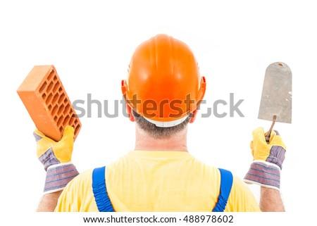 Mason holding brick and trowel Stock photo © photography33