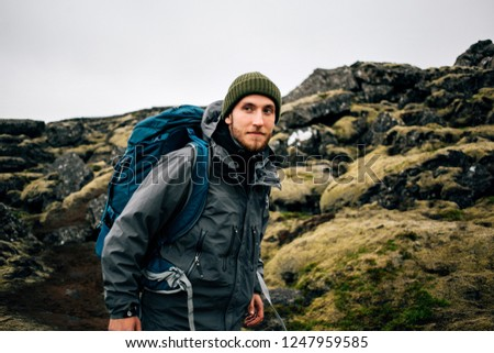 Handsome traveler with backpack and hiking poles  Stock photo © Nejron