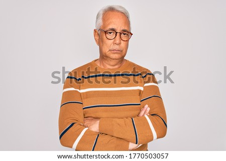 Portrait of a handsome man wearing a sweater, looking at the camera, on grey background Stock photo © feedough