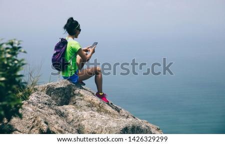 Young woman hiker enjoying the view Stock photo © dash