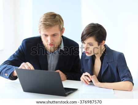 Portrait of a smiling young businesswoman in a suit talking Stock photo © deandrobot