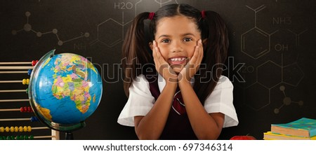 Schoolgirl leaning by globe and books against alphabet Stock photo © wavebreak_media