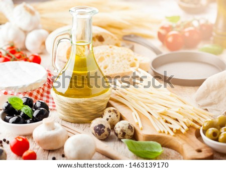 homemade spaghetti pasta with quail eggs with botle of olive oil and cheese on wooden background cl stock photo © denismart