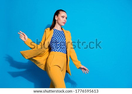 A young beautiful girl of model appearance in a bright colored jumpsuit on the street Stock photo © ElenaBatkova