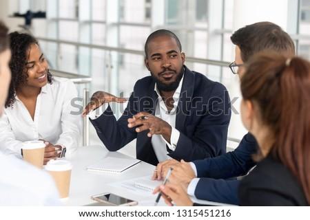 Kobieta posiedzenia pracy prezentacji spotkanie szczęśliwy Zdjęcia stock © photography33