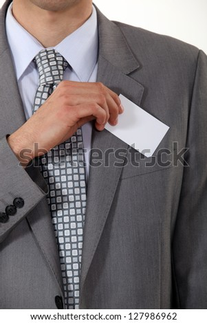 A cropped picture of a businessman showing his card. Stock photo © photography33