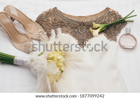 lace dress and golden heels Stock photo © dolgachov