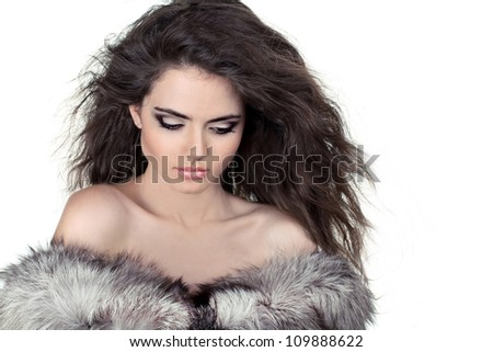 Young curly woman in white fur coat and shorts stock photo © maros_b