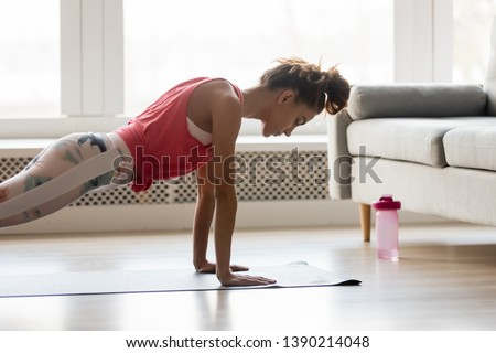 beautiful woman doing pushups stock photo © sumners