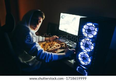 портрет назад молодые парень глядя экране Сток-фото © deandrobot