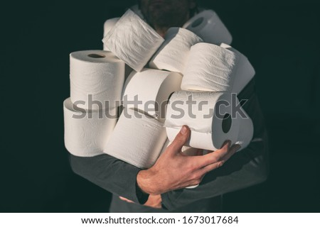 Toilet paper shortage coronavirus panic buying man hoarding carrying many rolls at home in fear of c Stock photo © Maridav