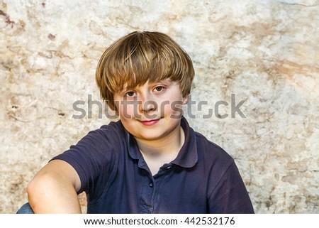 boy in the cellar with a spotlight stock photo © meinzahn