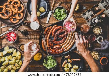 Konyha kolbász krumpli zöldségek hús főzés Stock fotó © karammiri