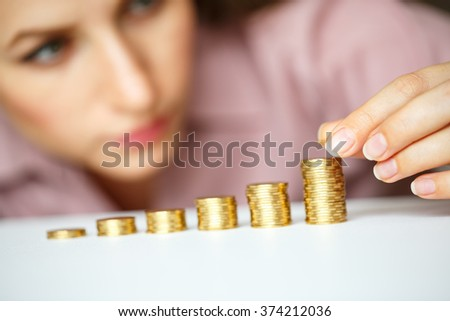 Business woman stacking gold coins into increasing columns Stock photo © vlad_star