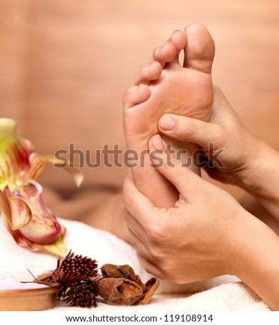 Massage of human foot in spa salon - Soft focus Stock photo © Yatsenko