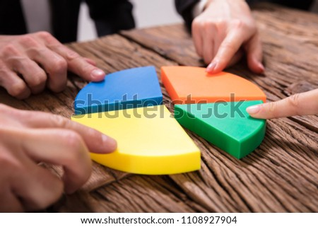 Businesspeople Connecting Pieces Of Pie Chart Stock photo © AndreyPopov