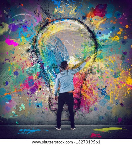 Drawing on a wall of a big light bulb. Concept of innovation and creativity Stock photo © alphaspirit
