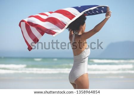вид сбоку женщину американский флаг пляж Сток-фото © wavebreak_media