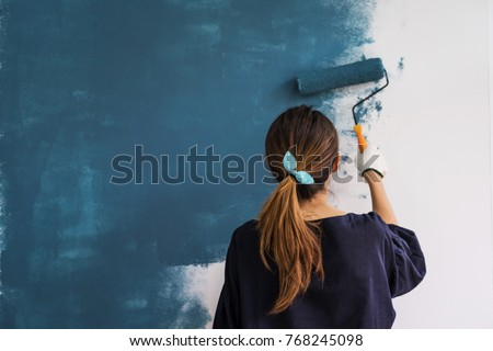 woman painting a wall stock photo © photography33