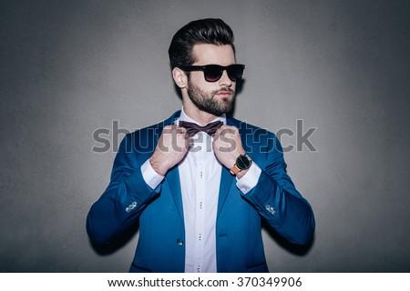 Handsome fashion man closing his jacket  Stock photo © feedough