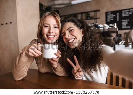female friends drinking tea with cake at cafe Stock photo © dolgachov