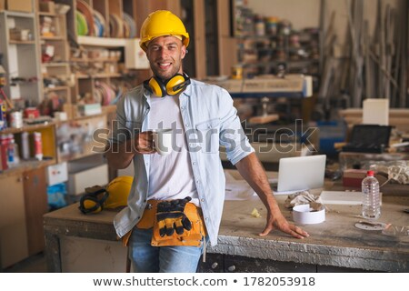 carpenters working and drinking coffee at workshop Stock photo © dolgachov