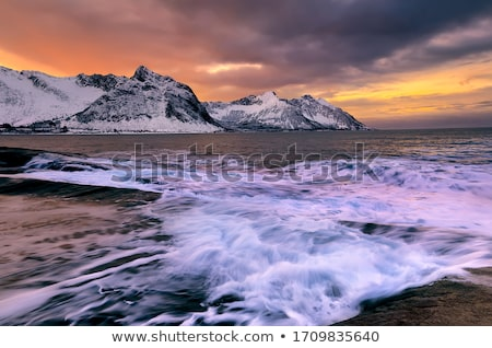 rocky coast at sunset long exposure shot stock photo © moses