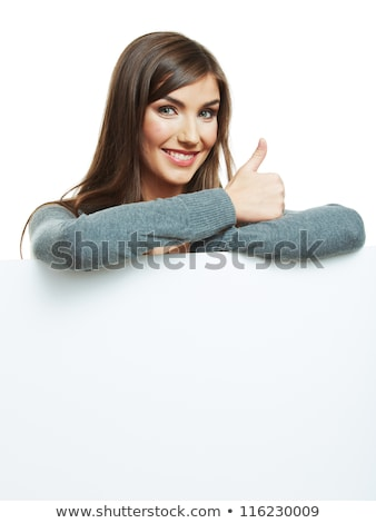 smiling woman holding a white sign board showing thumbs up stock photo © lichtmeister