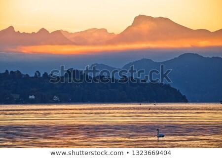 Jezioro złoty świcie łodzi górskich widoku Zdjęcia stock © xbrchx