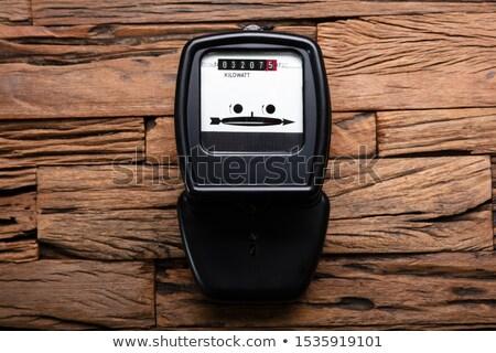 Kilowatt Meter On Wooden Desk Stock photo © AndreyPopov